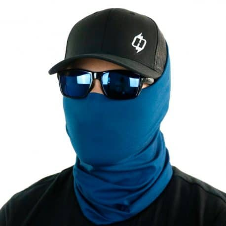 image of male model in a hat, sunglasses and solid blue color bandana being worn as a face mask