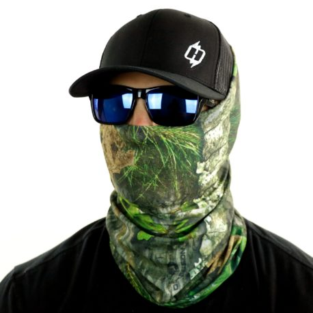 image of male model in hat, sunglasses and tubular bandana in mossy oak obsession design being worn as a face mask