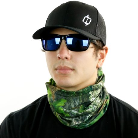 image of male model in hat, sunglasses and tubular bandana in mossy oak obsession design being worn as a neck gaiter