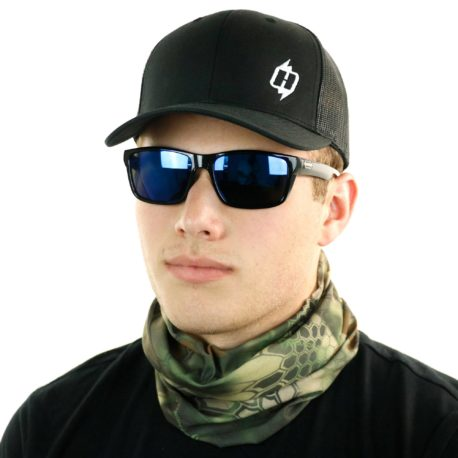 image of male model in hat, sunglasses and tubular bandana in kryptek mandrake design being worn as a neck gaiter