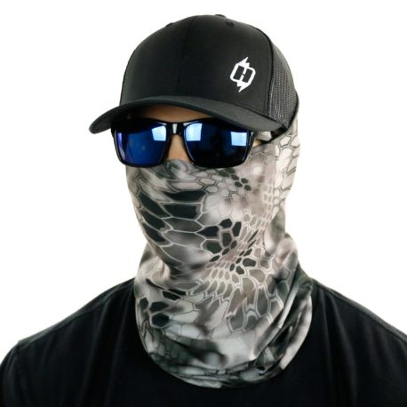 image of male model in hat, sunglasses and tubular bandana in kryptek raid design being worn as a face mask
