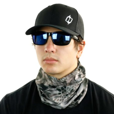 image of male model in hat, sunglasses and tubular bandana in kryptek raid design being worn as a neck gaiter