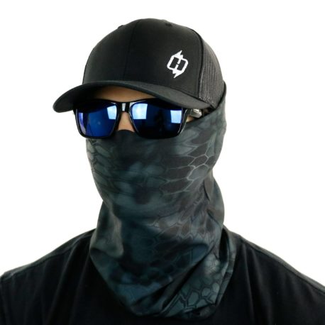 image of male model in hat, sunglasses and tubular bandana in kryptek typhon design being worn as a face mask