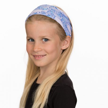 A young girl wearing a headband with whales and waves in shades of pink and blue
