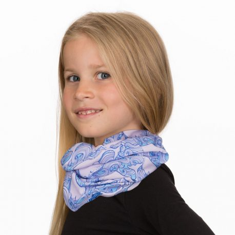 A young girl wearing a neck gaiter with whales and waves in shades of pink and blue