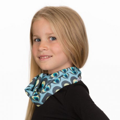 A young girl wearing a neck gaiter of light blue fabric with ovals designed to look like peacock feathers