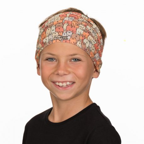 A young boy wearing a headband of cartoon bears in an overlapping pattern