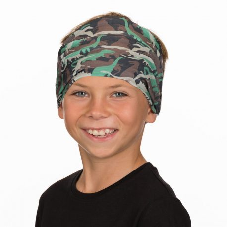 A young boy wearing a headband of different colored dinosaurs on a black fabric