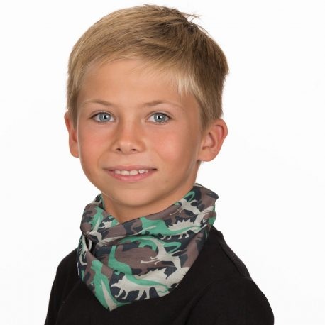 A young boy wearing a neck gaiter of different colored dinosaurs on a black fabric