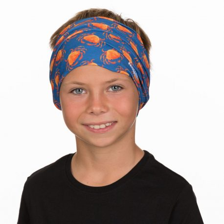 A young boy wearing a headband of orange crabs on navy fabric