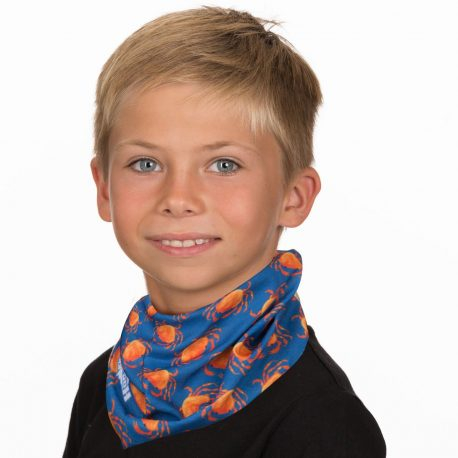 A young boy wearing a neck gaiter of orange crabs on navy fabric