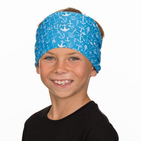 A young boy wearing a headband in aqua fabric covered in white anchors