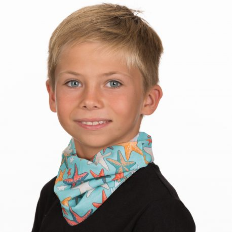 A young boy wearing a neck gaiter of different colored starfish on a light blue fabric