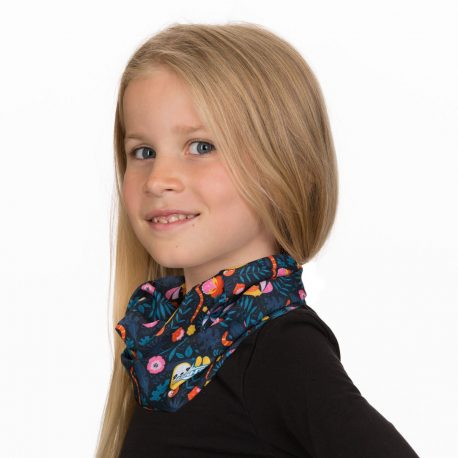 A young girl wearing a navy neck gaiter filled with images of sloths, toucans, butterflies and flowers