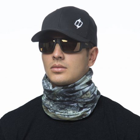 image of male model in hat, sunglasses and tubular bandana in mossy oak mountain country design being worn as a neck gaiter