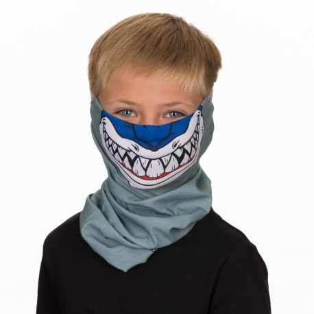 A young boy wearing a face mask of a shark on a gray background