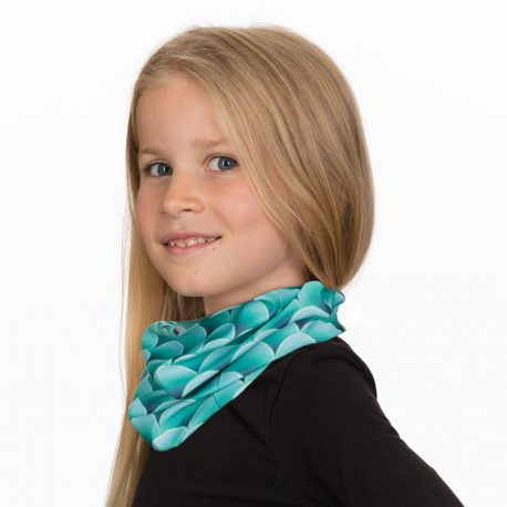 A young girl wearing a neck gaiter of green mermaid scales