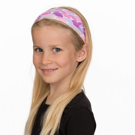 A young girl wearing a headband of pink, purple and peach mermaid scales