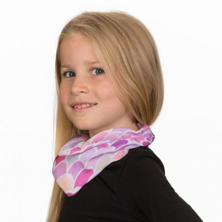 A young girl wearing a neck gaiter of pink, purple and peach mermaid scales