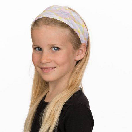 A young girl wearing a headband in a plaid pattern of light pink, blue, green, yellow and white colors