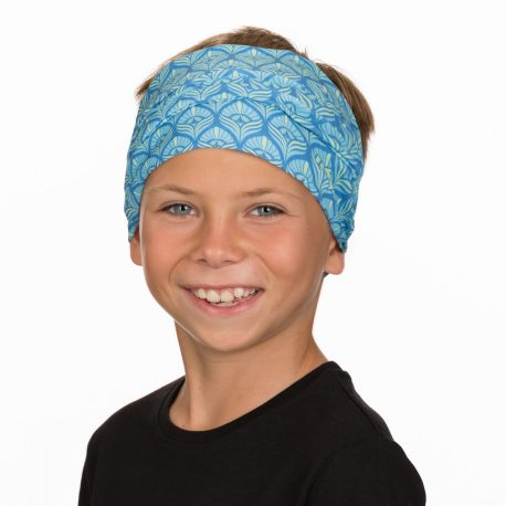 A young boy wearing a bandana of teal and blue oval shapes that resemble peacock feathers