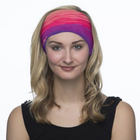 image of a female model in a pink and purple patterned bandana