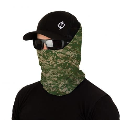 image of a male model in a hat, sunglasses and wearing a green and tan patterned face mask