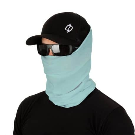 male model in sunglasses, hat and mint green face mask