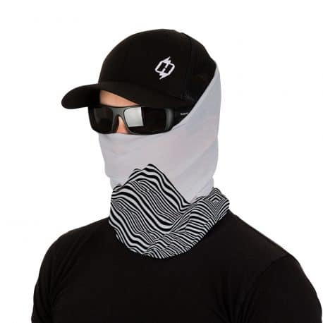 image of male model wearing a hat, sunglasses and a tubular bandana on gray background with black lines creating optical illusion of a mountain