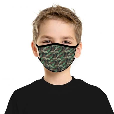 child model wearing an ear loop face mask with dinosaurs of different shapes and colors