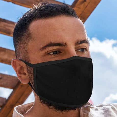 model wearing an ear loop face mask in solid black with black trim