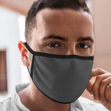model wearing an ear loop face mask in solid gray with black trim