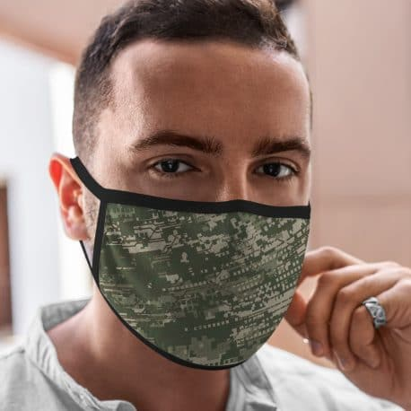 model wearing an ear loop face mask with a digital camo design in army green colors