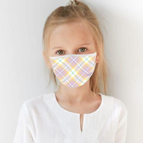 child model wearing an ear loop face mask with yellow, pink and purple lines in a plaid print