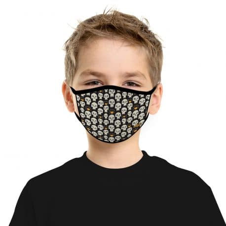 child model wearing an ear loop face mask with white cartoon skulls and gold crowns
