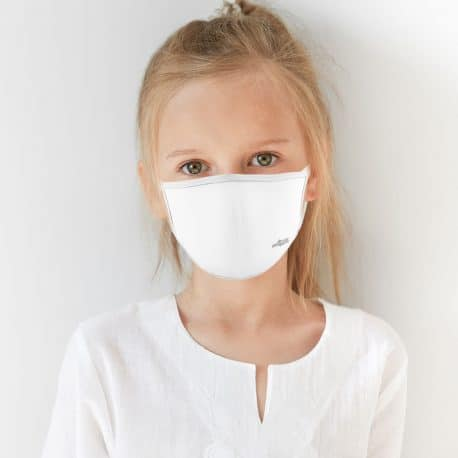 child model wearing an ear loop face mask in solid white with white trim