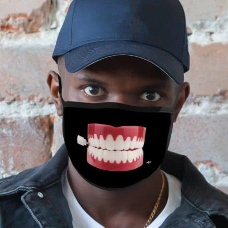 image of male model wearing an ear loop face mask featuring a chatterbox on black background
