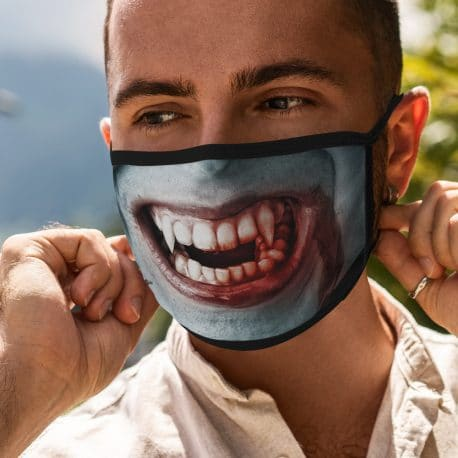 image of a male model wearing an ear loop face mask with a vampire smile design