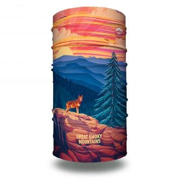 image of a wolf on a mountain side with a tree and mountains in the background. this image showcases the great smoky mountains national parks on a bandana.